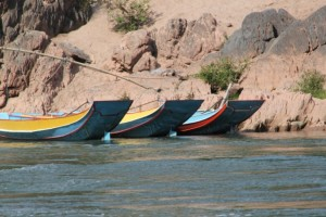 Fishing canoes moored along the river bank