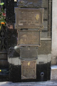 many well-wishing plates next to Eva's tomb