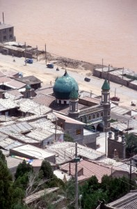 mosque and houses on the slope of White Pagoda Hill