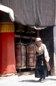woman doing the rounds along the prayer wheels