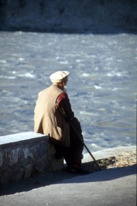 man contemplating the Gilgit river