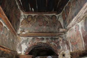 frescoed church interior, in need of repairs