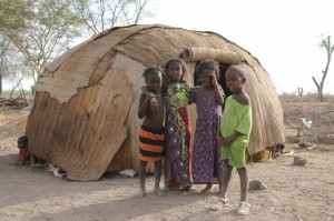 Afar kids in front of their home