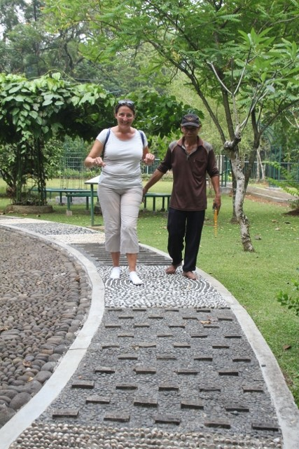 the specially designed path to stimulate reflexes under the soles of your feet, and the old gardener helping some haphazard tourist along