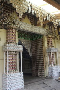 the coffee palace, front porch entirely hung with coffee sachets