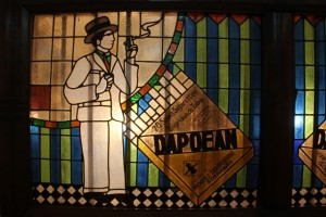 a stained glass window in the House of Sampoerna