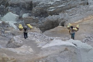 sulphur workers carrying up their loaded baskets