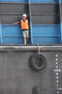sailor on one of the coal barges on the Mahakam River