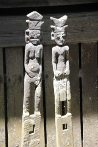 wooden statues at the longhouse cum losmen in Tanjung Isuy