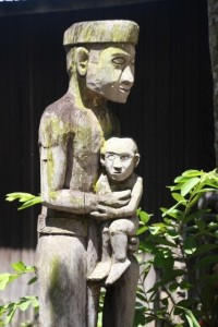one of the patongs - wooden statues - outside the longhouse