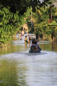 a street in Tering Lama under water, calling for canoe use