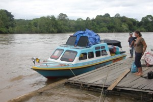 our speedboat (to the right, the only other bule on the river)