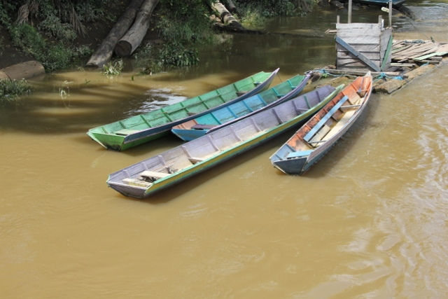 colourful canoes moored along the river
