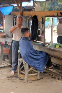 a haircut in the open, also part of the market