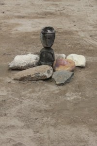 in the village square, a sculpture surrounded by rocks: the praying area