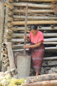 woman pounding vegetables in Kampung Tarung