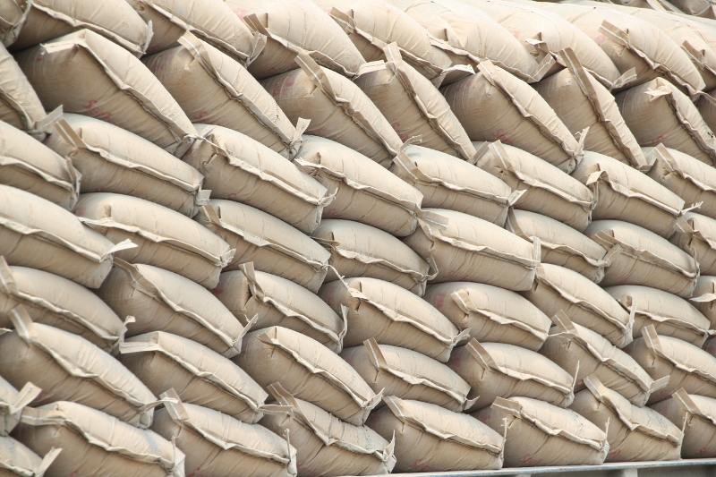 neatly stacked cement bags waiting to be loaded