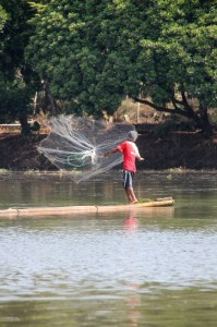 fisherman trying to catch some fish