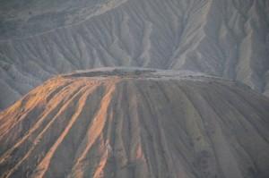 illuminated extinct crater of Gunung Batok, next to Bromo