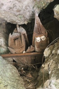 coffins decorated with skulls, in Tampangallo cave