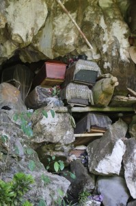 coffins stuffed in a natural fissure in a cave in Londa