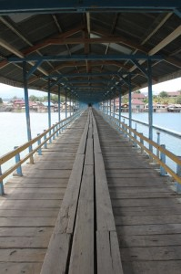 the covered bridge across the Poso River in Tentana