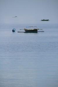 fishing canoe moored offshore from Ampana beach