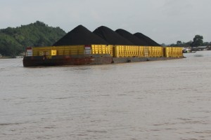 coal barge traveling down river