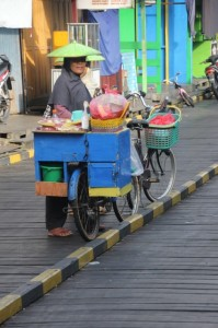 women selling from their bicycles on the main board walk of Muara Muntai