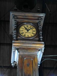 inside the market stands a huge wooden clock