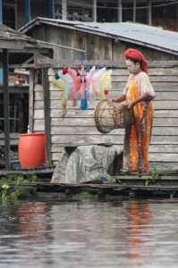 woman with whitened face in Muara Ohong