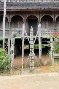 "the ""stairs"" – a carved pole – to the first level"
