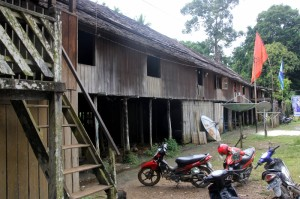 the longhouse, adapted to modern times, including motorbikes and satellite dishes