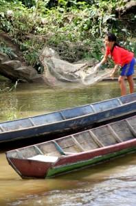 girl fishing along the river bank