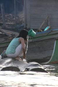 girl washing near the market