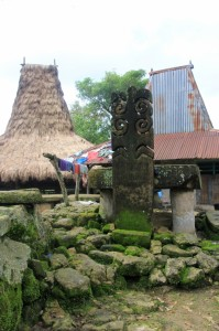 stone carving in the center of the Kampung
