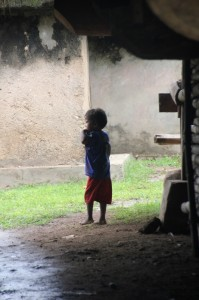 one of the youngsters in the entrance to a clan kampung