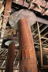 and the finely carved support poles inside the houses