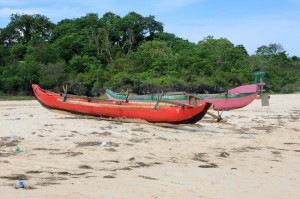 fishing canoes pulled up onto the beach