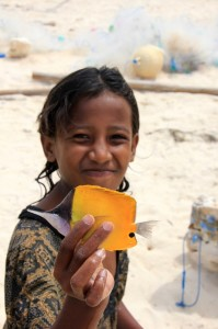 girl showing the catch of the day on Waikelo beach
