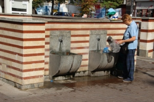 near the haman is also a public water supply, lots of people collect their water from here, in plastic bottles