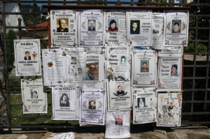 an interesting Bulgarian practice: posters of the deceased next to the church