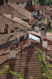 roofs and chimneys, solar panels and a satelite dish