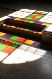 the modern stained-glass windows of the Capriani Monastry church reflected on the floor