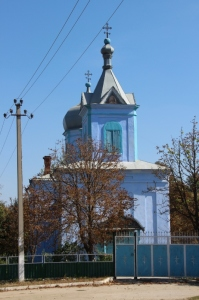 the blue church in a rural village