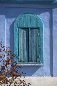 a blue church window in rural Moldova