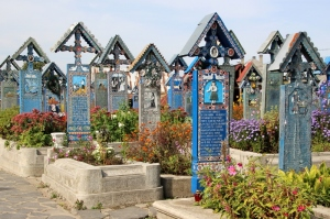 blue crosses with poems and images in the Merry Cemetery in Sapanta