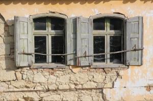 two windows in a Hungarian village in Transylvania
