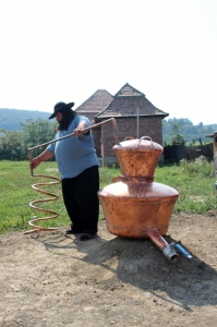 Caldarari man assembling a distillation kettle, one of their most popular products, it seems