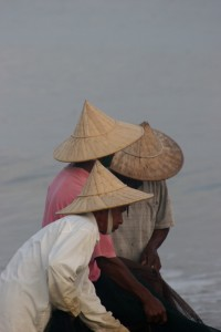 three of the fishermen working a net